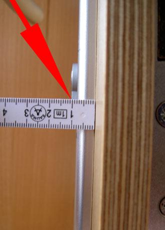 Mida en la parte interior la distancia entre la puerta y el final del cilindro.